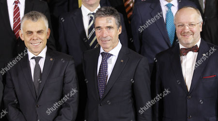 Maciej Popowski, Deputy Secretary-General, European External Action Service, left, Anders Fogh Ramussess, Secretary General of NATO, centre, and Lt. General Ton Van Osch, EUMS, right, join EU Defence Ministers for a group photograph in Dublin Castle, Ireland, . The working sessions of the meeting is to cover all topics related to the Common Security and Defence Policy and point the way forward for the direction of topics within CSDP