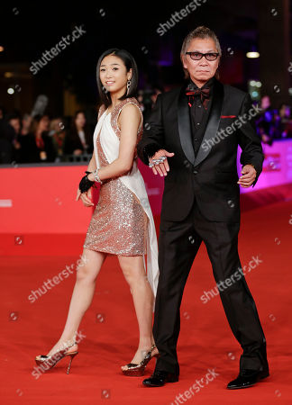 Erina Mizuno, Takashi Miike Actress Erina Mizuno, left, and director Takashi Miike arrive for the opening ceremony of the 7th edition of the Rome International Film Festival in Rome
