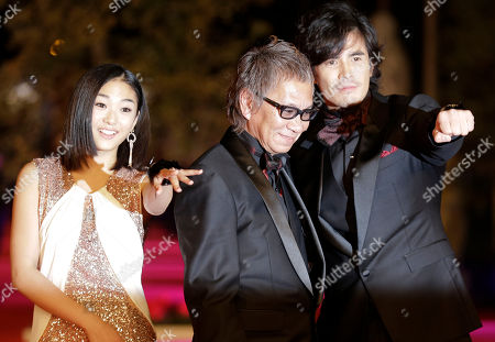 Takashi Miike, Erina Mizuno, Hideaki Ito From left, actress Erina Mizuno, director Takashi Miike, and actor Hideaki Ito arrive for the opening ceremony of the 7th edition of the Rome International Film Festival in Rome