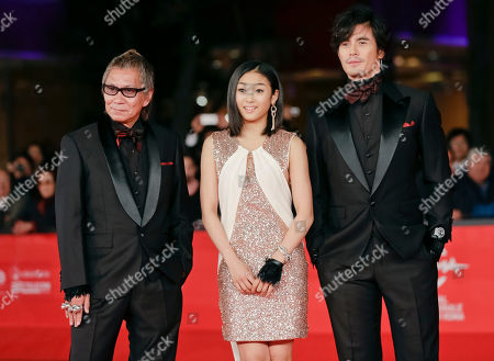 Takashi Miike, Erina Mizuno, Hideaki Ito From left, director Takashi Miike, actors Erina Mizuno, and Hideaki Ito arrive for the opening ceremony of the 7th edition of the Rome International Film Festival in Rome