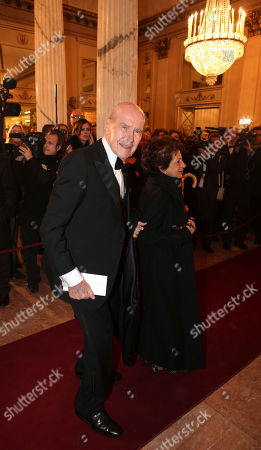 """Umberto Veronesi and his wife arrive at the Milan La Scala theater, Italy, . The famed La Scala opera house inaugurates its 2012-13 season Friday with the Teutonic classic """"Lohengrin"""" as it launches dual bicentennial celebrations of its own Giuseppe Verdi and German icon Richard Wagner. Daniel Barenboim, La Scala's music director and a Wagner aficionado, conducts the gala season opener, one of the premier events on the European cultural calendar"""