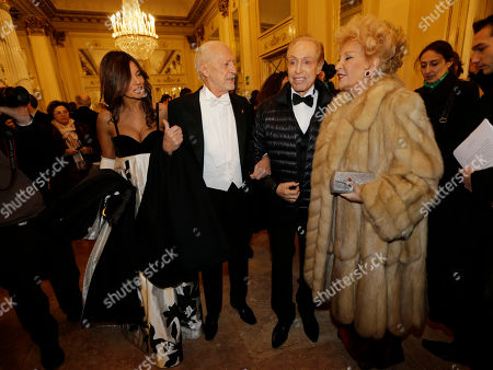 "Italian fashion designer Lorenzo Riva, Renato Balestra and Marinella di Capua arrive at the Milan La Scala theater, Italy, . The famed La Scala opera house inaugurates its 2012-13 season Friday with the Teutonic classic ""Lohengrin"" as it launches dual bicentennial celebrations of its own Giuseppe Verdi and German icon Richard Wagner. Daniel Barenboim, La Scala's music director and a Wagner aficionado, conducts the gala season opener, one of the premier events on the European cultural calendar"