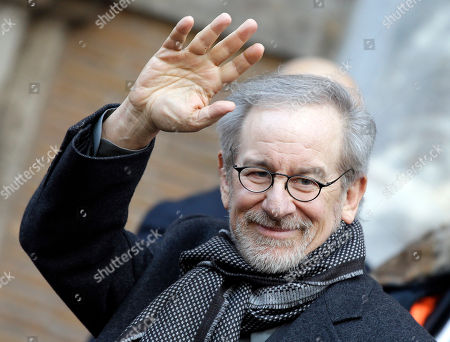 """Director Steven Spielberg waves to photographers as he leaves the Italian senate after meeting the president of the Senate Renato Schifani, in Rome, . Spielberg is in Rome to present the movie """"Lincoln"""