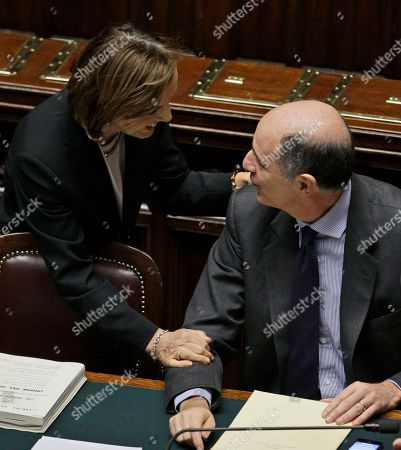 Stock Photo of Welfare Minister Elsa Fornero, left, shares a word with Minister for Economic Development Corrado Passera prior to a confidence vote at the Lower Chamber, in Rome