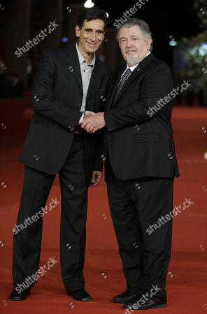 """Writer and screen player Alessandro Camon, left, and director Walter Hill pose as they arrive for the screening of the movie """"Bullet to the Head"""" at the 7th edition of the Rome International Film Festival in Rome"""
