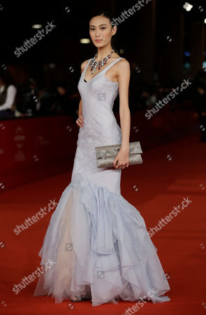 "Chinese model Shu Pei poses as she arrives for the screening of the movie ""Bullet to the Head"" at the 7th edition of the Rome International Film Festival in Rome"