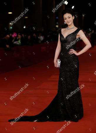 "Chinese actress Li Xiaoran poses as she arrives for the screening of the movie ""Bullet to the Head"" at the 7th edition of the Rome International Film Festival in Rome"