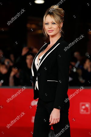 "Actress Anna Falchi poses as she arrives for the screening of the movie ""E la chiamano estate"" (and they call it summer), at the 7th edition of the Rome International Film Festival in Rome"