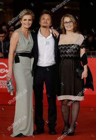 """Director Paolo Franchi, center, poses with actress Isabella Ferrari, left, and producer Nicoletta Mantovani as they arrive for the screening of the movie """"E la chiamano estate"""" (and they call it summer), at the 7th edition of the Rome International Film Festival in Rome"""