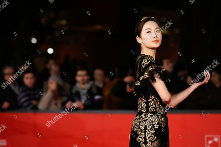 """LI Chengyuan Actress Li Chengyuan poses for photographers as she arrives for the screening of her movie """"Judge Archer"""" during the 7th edition of the Rome International Film Festival in Rome"""