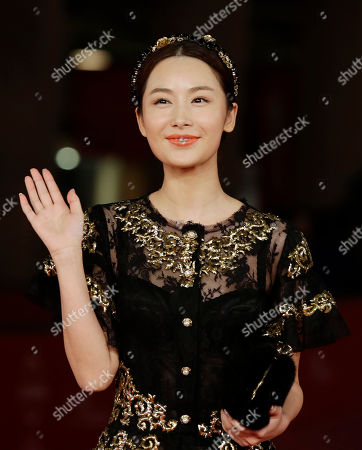 """Actress LI Chengyuan poses for photographers as she arrives for the screening of her movie """"Judge Archer"""" during the 7th edition of the Rome International Film Festival in Rome"""