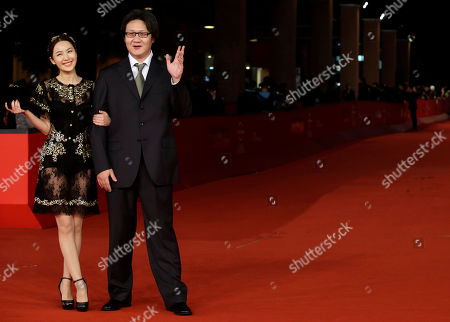 """Stock Image of LI Chengyuan, Xu Haofeng Actress LI Chengyuan and DIrector Xu Haofeng pose for photographers as they arrive for the screening of their movie """"Judge Archer"""" during the 7th edition of the Rome International Film Festival in Rome"""