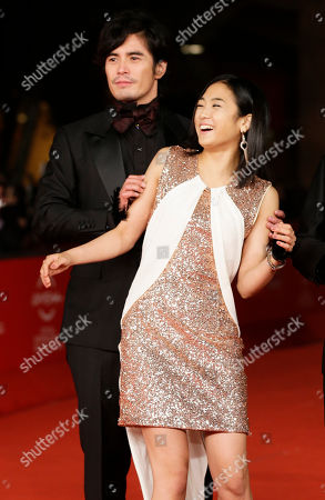 "Hideaki Ito, Erina Mizuno Actors Hideaki Ito, left, and Erina Mizuno joke as they arrive for the premiere of the movie ""Lesson of the evil"" at the 7th edition of the Rome International Film Festival in Rome"