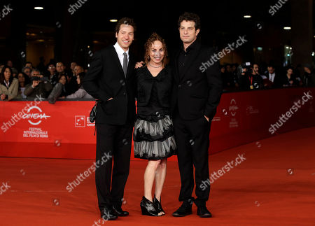 """Alan Polsky, Gabe Polsky Director and producers Alan Polsky, left, and Gabe Polsky pose for photographers with their mother Maya as they arrive for the screening of their movie """"The Motel Life"""" during the 7th edition of the Rome International Film Festival in Rome"""