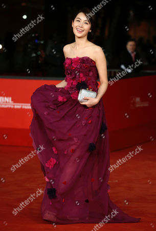 "Stock Photo of Li Cheng Yuan Actress Li Cheng Yuan poses as she arrives for the screening of the movie ""Duzhan"", at the 7th edition of the Rome International Film Festival in Rome"