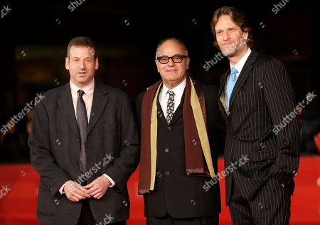 Director Amos Poe, center, arrives with Michael Laurence, right, and cinematographer Brian Fass for the opening ceremony of the 7th edition of the Rome International Film Festival in Rome