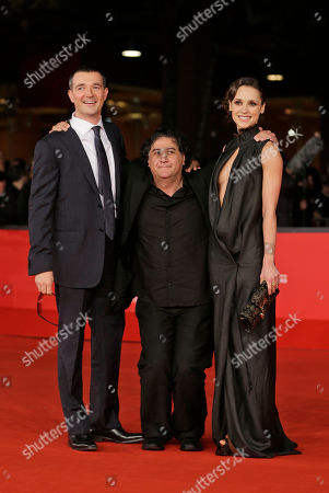 Stock Photo of From left, actor Egor Beroev, Director Bakhtiar Khudojnazarov, and actress Anastasia Mikulchina arrive for the opening ceremony of the 7th edition of the Rome International Film Festival in Rome