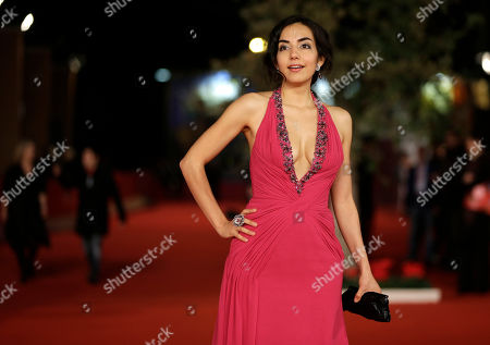 """Actress Tina Rodriguez poses for photographers as she arrives for the screening of her movie """"Marfa Girl"""" at the 7th edition of the Rome International Film Festival in Rome"""