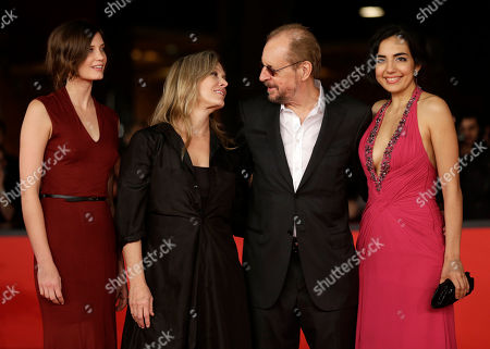 "From left, actresses Drake Burnette, Mary Farley, director Larry Clark, and Tina Rodriguez, pose for photographers as they arrive for the screening of their movie ""Marfa Girl"" at the 7th edition of the Rome International Film Festival in Rome"