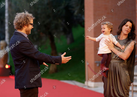 """Stock Photo of Enrique Rivero Director Enrique Rivero poses for photographers with his daughter Maya, center, and his wife Alba, as he arrives to present his movie """"Mai Morire"""" at the 7th edition of the Rome International Film Festival in Rome"""