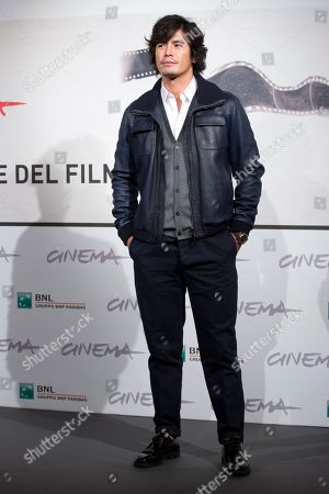 """Actor Hideaki Ito poses during the photo call of the movie """"Lesson of Evil"""" at the Rome Film Festival, in Rome"""
