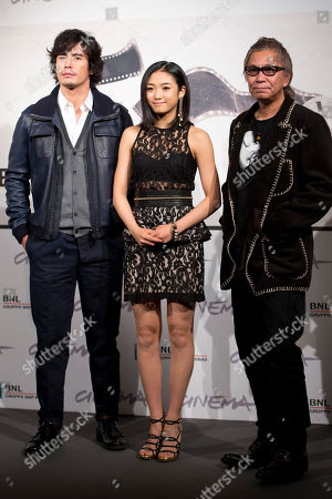 "From left, actor Hideaki Ito, director Takashi Miike and actress Erina Mizuno pose during the photo call of the movie ""Lesson of Evil"" at the Rome Film Festival, in Rome"
