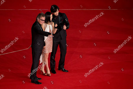 From left, Director Takashi Miike, actress Erina Mizuno and actor Actor Hideaki Ito pose for photographers as they arrive to attend the opening ceremony of the Rome Film Festival, in Rome