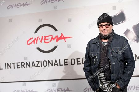 "Director Amos Poe poses during the photo call of the movie ""A Walk in the Park"" at the Rome Film Festival, in Rome"
