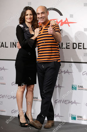 """Jean-Marc Barr, Anita Kravos Actress Anita Kravos, left, and actor Jean-Marc Barr pose during the photo call of the movie """"E la chiamano estate"""" (And They Call it Summer) at the 7th edition of the Rome International Film Festival in Rome"""