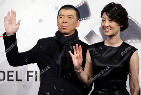 """Director Feng Xiaogang and actress Xu Fan pose during a photocall presenting their movie """"1942"""" during the 7th edition of the Rome International Film Festival in Rome"""
