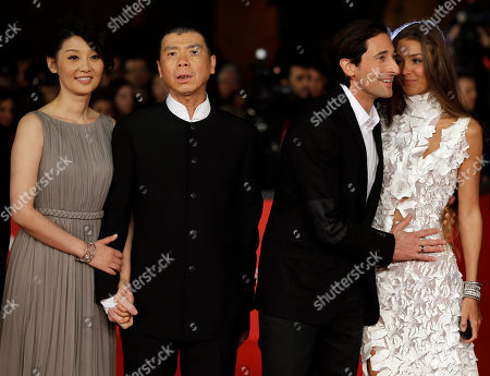 """From left, actress Xu Fan, director Feng Xiaogang, actor Adrien Brody and his girlfriend Lara Lieto pose for photographers as they arrive for the screening of their movie """"1942"""" during the 7th edition of the Rome International Film Festival in Rome"""