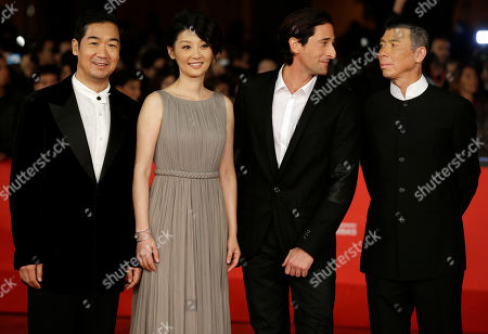 """From left, actor Zhang Guoli, actress Xu Fan, actor Adrien Brody and director Feng Xiaogang pose for photographers as they arrive for the screening of their movie """"1942"""" during the 7th edition of the Rome International Film Festival in Rome"""