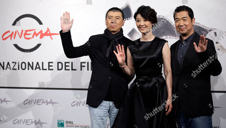 """From left, Director Feng Xiaogang, actress Xu Fan and actor Zhang Guoli pose during a photo call presenting their movie """"1942"""" during the 7th edition of the Rome International Film Festival in Rome"""