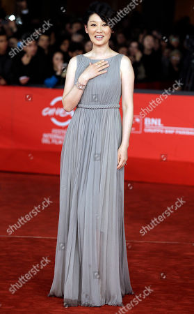 """Actress Xu Fan poses for photographers as she arrives for the screening of the movie """"1942"""" during the 7th edition of the Rome International Film Festival in Rome"""
