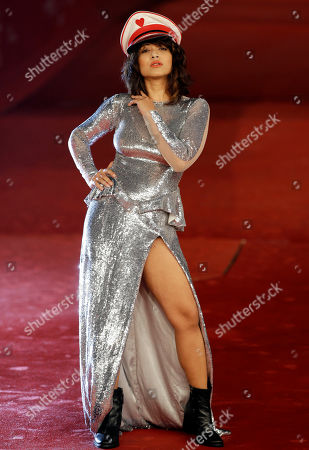 """Actress Rimi Sen poses for photographers as she arrives for the screening of her movie """"Tasher Desh"""" during the 7th edition of the Rome International Film Festival in Rome"""
