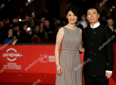 """Actress Xu Fan and director Feng Xiaogang pose for photographers as they arrive for the screening of their movie """"1942"""" during the 7th edition of the Rome International Film Festival in Rome"""