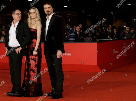 "From left, director Pappi Corsicato, actress Laura Chiatti, and actor Alessandro Preziosi pose for photographers as they arrive for the screening of their movie ""Il volto di un'altra"" at the 7th edition of the Rome International Film Festival in Rome"