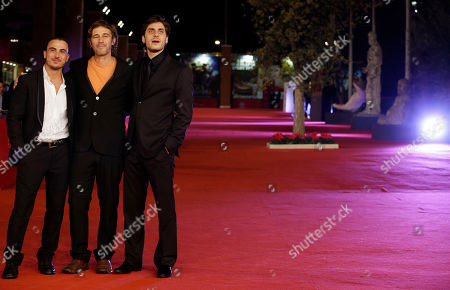 "From left, actor Francesco Di Leva, director Corrado Sassi and actor Luca Marinelli pose for photographers as they arrive for the screening of their movie""Waves"" during the 7th edition of the Rome International Film Festival in Rome"