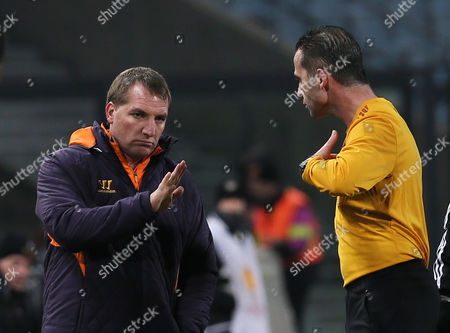 Stock Photo of Liverpool's coach Brendan Rodgers talks with referee Duarte Gomes, during the UEFA Europa League Group A soccer match between Udinese and Liverpool, at the Friuli Stadium in Udine, Italy