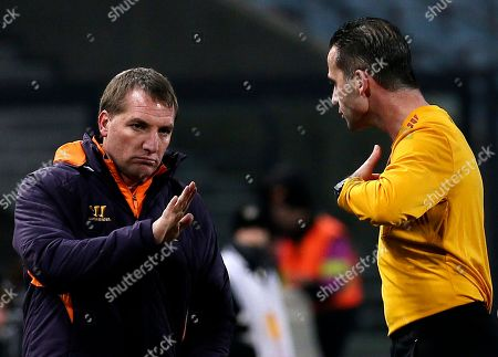 Liverpool's coach Brendan Rodgers talks with referee Duarte Gomes during the Europa League Group A soccer match between Udinese and Liverpool, at the Friuli Stadium in Udine, Italy