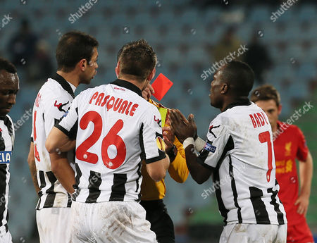 Referee Duarte Gomes, shows the red card to Udinese's Giovanni Pasquale, during the UEFA Europa League Group A soccer match between Udinese and Liverpool, at the Friuli Stadium in Udine, Italy
