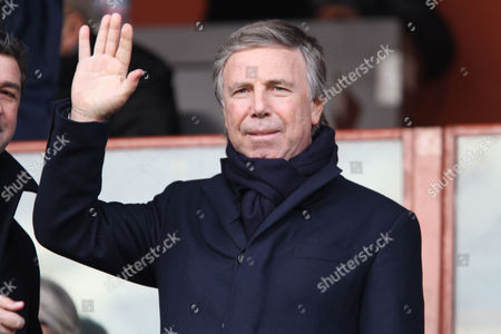 Genoa President Enrico Preziosi waves to fans prior to the start of a Serie A soccer match between Genoa and Udinese, in Genoa's Luigi Ferraris Stadium, Italy