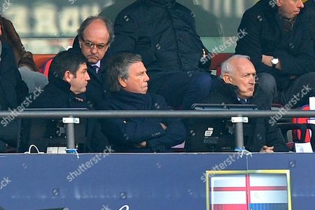Genoa President Enrico Preziosi, second form left, follows the game of a Serie A soccer match between Genoa and Udinese, in Genoa's Luigi Ferraris Stadium, Italy