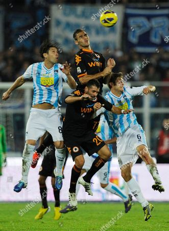 Pescara's defender Christian Terlizzi, AS Roma's midfielder Simone Perrotta, Pescara's defender Simone Romagnoli jump for the ball during a Serie A soccer match between Pescara and AS Roma, at the Adriatico stadium in Pescara, Italy