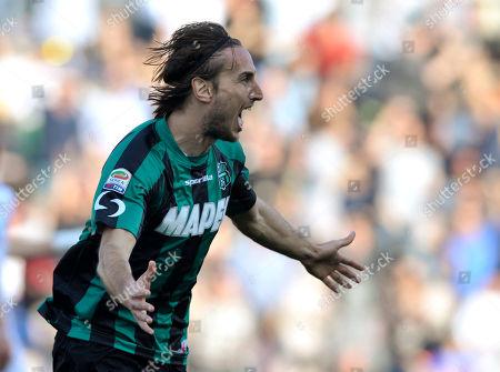 Sassuolo's Simone Missiroli celebrates after scoring a goal during a Serie A soccer match against Catania, at Reggio Emilia's Mapei stadium, Italy