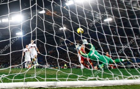 AS Roma Argentine forward Erik Lamela of Argentina, center scores past AC Milan goalkeeper Marco Amelia during a Serie A soccer match between AS Roma and AC Milan, at Rome's Olympic stadium
