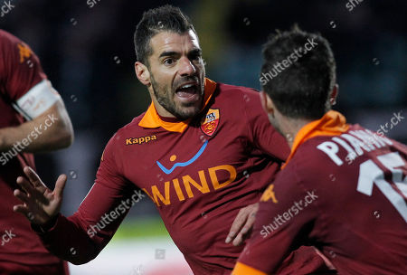 AS Roma's Simone Perrotta celebrates after scoring during a Serie A soccer match between Siena and AS Roma, in Siena, Italy