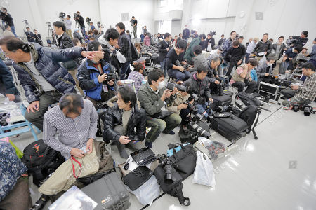 Photographers get ready for a news conference by Japanese singer and actress Noriko Sakai in Tokyo as she came back to the entertainment industry, a day after she finished her three years on parole. Sakai, once hugely popular in Asia, was convicted of drug use in 2009