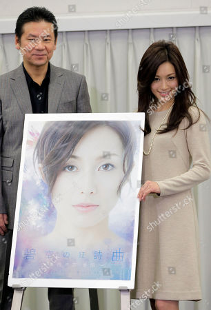 Noriko Sakai, Masayuki Imai Japanese singer and actress Noriko Sakai, right, and actor Masayuki Imai stand by a poster of of their new stage titled 'Rhapsody of Azure Sky' and waves during a news conference in Tokyo as she came back to the entertainment industry, a day after she finished her three years on parole. Sakai, once hugely popular in Asia, was convicted of drug use in 2009