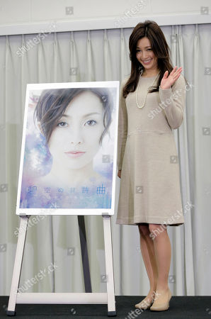 Noriko Sakai Japanese singer and actress Noriko Sakai stands by a poster of of her new stage titled 'Rhapsody of Azure Sky' and waves during a news conference in Tokyo as she came back to the entertainment industry, a day after she finished her three years on parole. Sakai, once hugely popular in Asia, was convicted of drug use in 2009